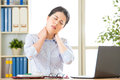 Young asian business woman with pain in neck Royalty Free Stock Photo