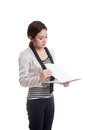 Young Asian business woman read paper on clipboard. Royalty Free Stock Photo