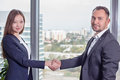 Young asian business woman in suit shakes hands with his business partner women at office panoramic views Stock Photos