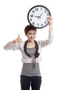 Young Asian business woman thumbs up with a clock.