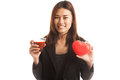 Young Asian business woman with tomato juice and red heart. Royalty Free Stock Photo