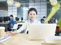 Young asian business woman working in office Royalty Free Stock Photo