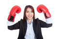 Young Asian businesswoman with boxing glove Royalty Free Stock Photo