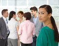 Young asian businesswoman and business team looking back in background Royalty Free Stock Images