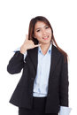 Young asian businesswoman gesturing phone call isolated on white background Royalty Free Stock Photo