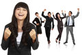 stock image of  Young asian businesswoman with her team behind, make a success g