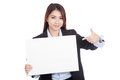Young Asian businesswoman point to blank sign Royalty Free Stock Photo