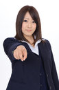 Young asian businesswoman pointing rise hand and in front Stock Image
