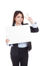 Young Asian businesswoman show victory sign and  blank sign Royalty Free Stock Photo