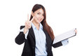 Young Asian businesswoman show victory sign with clipboard Royalty Free Stock Photo