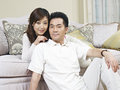 Young asian couple home portrait of a Stock Photography