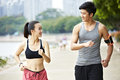 Young asian couple jogging outdoors Royalty Free Stock Photo