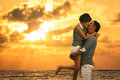 Young asian couple in love staying and kissing on the beach sunset Royalty Free Stock Photo