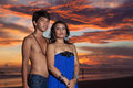 Young asian couple at sunset in bali Royalty Free Stock Photography