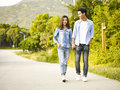 Young asian couple taking a walk Royalty Free Stock Photo