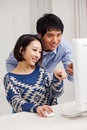 Young Asian couple using PC Stock Photos