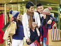 Young asian couples enjoying shopping in mall Royalty Free Stock Photo
