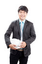 Young asian engineering man standing and holding safety helmet i Royalty Free Stock Photo