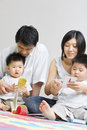 Young Asian family spending time together Stock Photos
