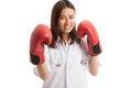 Young Asian female doctor ready to fight. Royalty Free Stock Photo