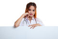 Young Asian female doctor standing behind blank white billboard. Royalty Free Stock Photo
