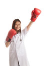 Young Asian female doctor win the fight. Royalty Free Stock Photo