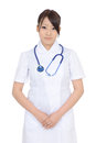 Young asian female nurse with hands crossed isolated on white background Stock Photo