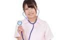 Young asian female nurse showing stethoscope Royalty Free Stock Images