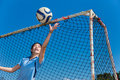 Young asian girl goalkeeper catching the ball Royalty Free Stock Photo