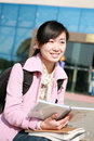 Young asian girl holding books Stock Images