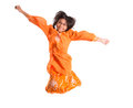 Young asian girl jumping happily ii malay wearing a traditional malay dress the baju kurung Royalty Free Stock Image