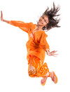 Young asian girl jumping happily iii malay wearing a traditional malay dress the baju kurung Royalty Free Stock Photos