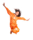 Young asian girl jumping happily iv malay wearing a traditional malay dress the baju kurung Stock Image