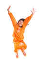 Young asian girl jumping happily ix malay wearing a traditional malay dress the baju kurung Royalty Free Stock Image