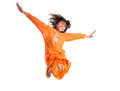 Young asian girl jumping happily vi malay wearing a traditional malay dress the baju kurung Stock Image