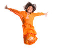 Young asian girl jumping happily viii malay wearing a traditional malay dress the baju kurung Royalty Free Stock Photo