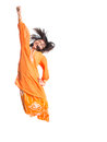 Young asian girl jumping happily xiv malay wearing a traditional malay dress the baju kurung Royalty Free Stock Photos