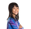 Young asian girl in malay traditional dress i preteen baju kurung over white background Royalty Free Stock Image
