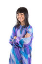 Young asian girl in malay traditional dress ii preteen baju kurung over white background Royalty Free Stock Image