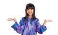 Young asian girl in malay traditional dress iv preteen baju kurung over white background Stock Photo