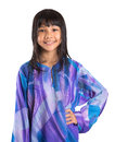 Young asian girl in malay traditional dress ix preteen baju kurung over white background Stock Photography