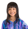 Young asian girl in malay traditional dress viii preteen baju kurung over white background Royalty Free Stock Image