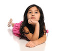 Young Asian Girl Laying on White Floor Royalty Free Stock Photo
