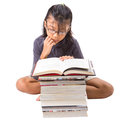 Young asian girl reading books iv malay on a white background Stock Photography