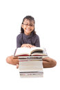 Young asian girl reading books v malay on a white background Royalty Free Stock Photo