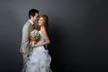 Young asian groom and bride posing and smiling in studio for pre Royalty Free Stock Photo