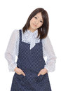 Young asian housewife dressed in apron with hands pockets Royalty Free Stock Photography