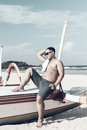 Young asian indonesian man relaxing on the beach of tropical Bali island, Indonesia. Royalty Free Stock Photo