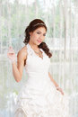 Young asian lady in white bride dress model is thai ethnicity Royalty Free Stock Photography