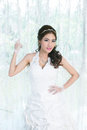 Young asian lady in white bride dress model is thai ethnicity Stock Photo